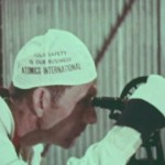 """AI worker wears hat stating """"your safety is our business"""""""
